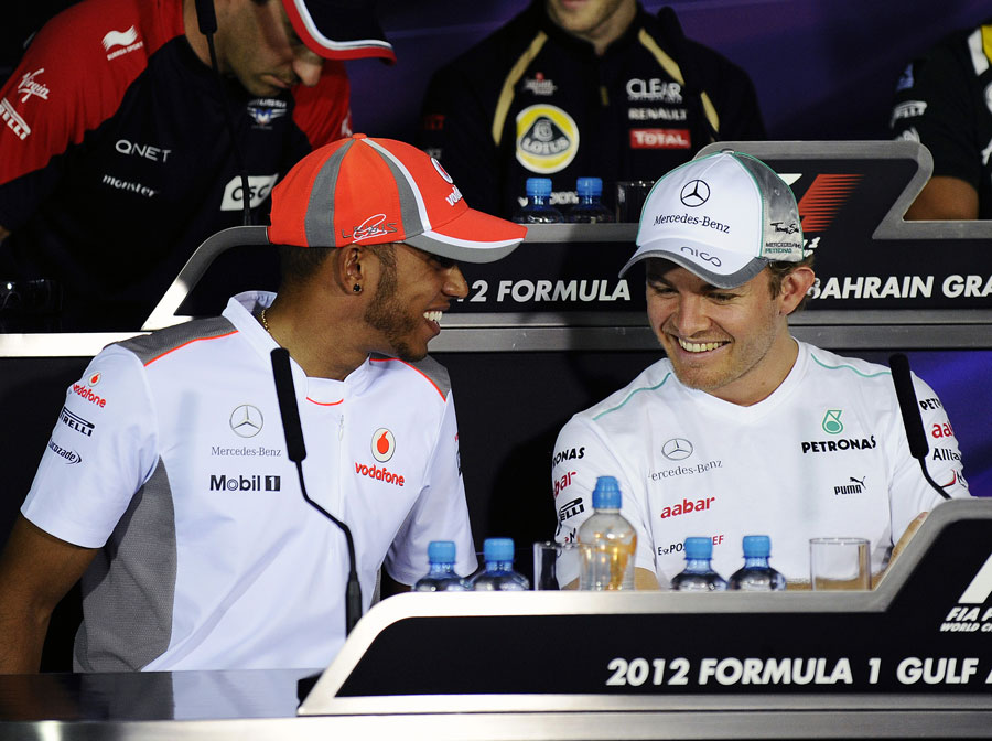 Nico Rosberg and Lewis Hamilton share a joke during the driver press conference