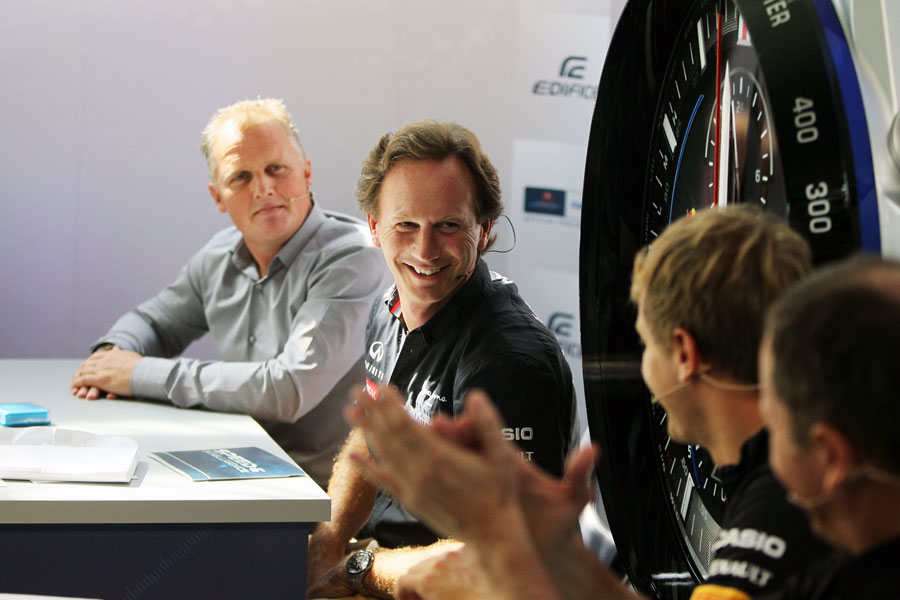 Christian Horner jokes with Sebastian Vettel during a sponsors' quiz in the paddock on Thursday