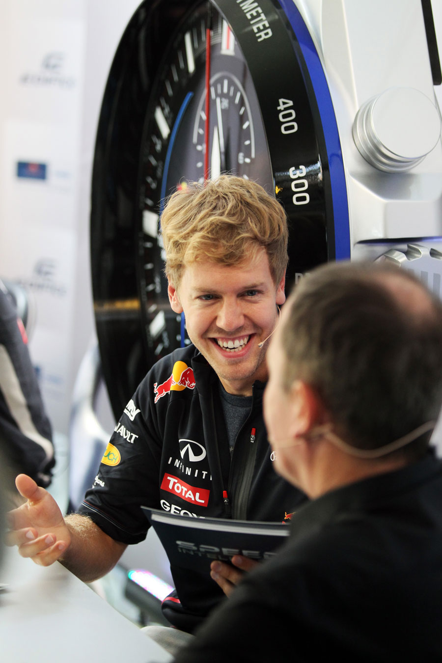 Sebastian Vettel laughs during a sponsors' quiz in the paddock on Thursday