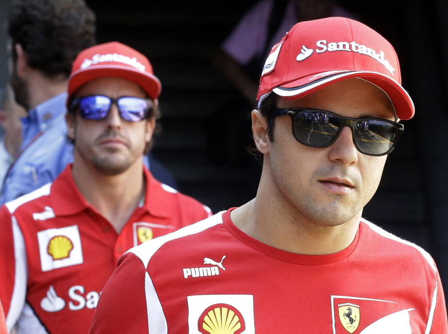 Fernando Alonso follows Felipe Massa in the paddock