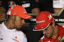 Fernando Alonso and Lewis Hamilton chat during the driver press conference