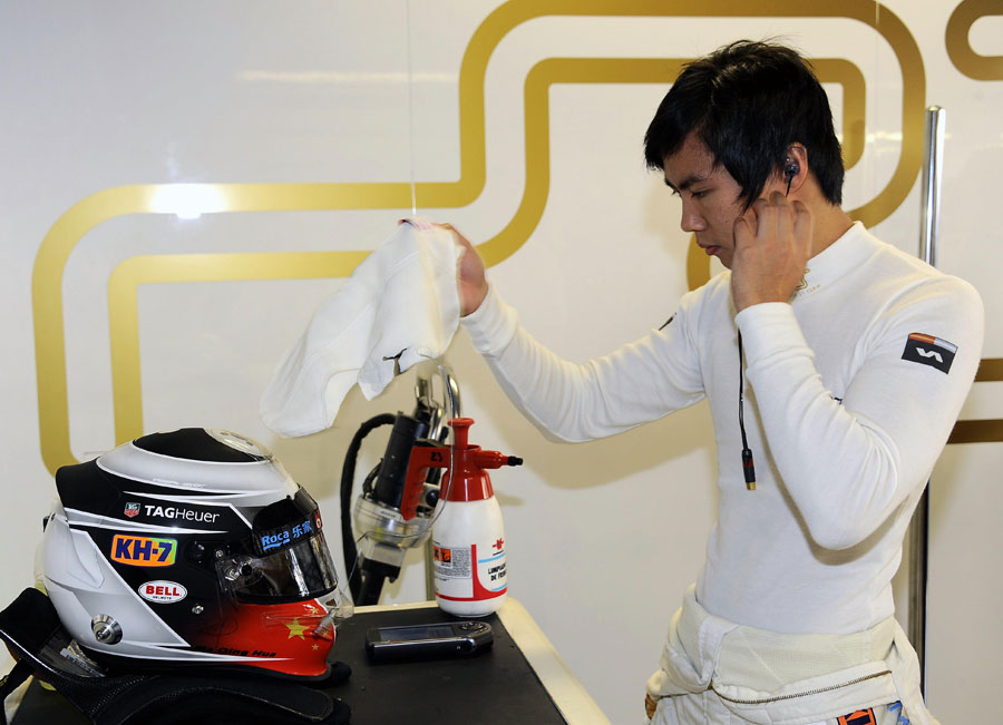 Ma Qing Hua prepares for his first outing in an F1 car