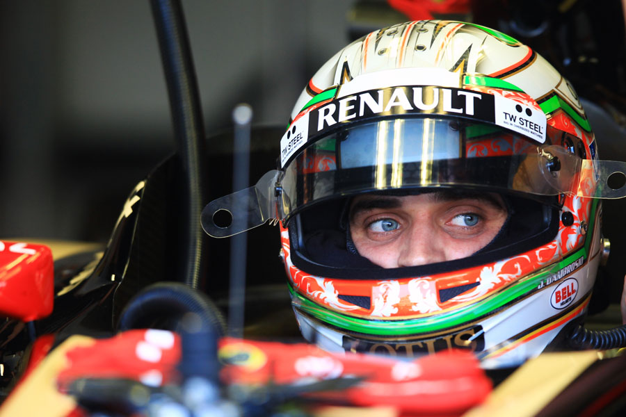Jerome d'Ambrosio sits in the Lotus garage awaiting the start of his first session since Brazil 2011