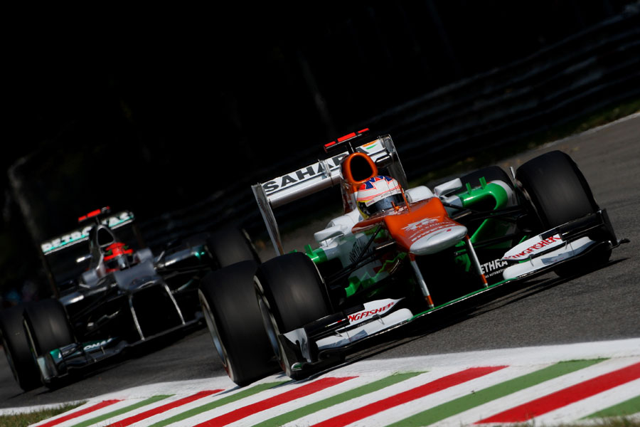 Paul di Resta leads Michael Schumacher on track