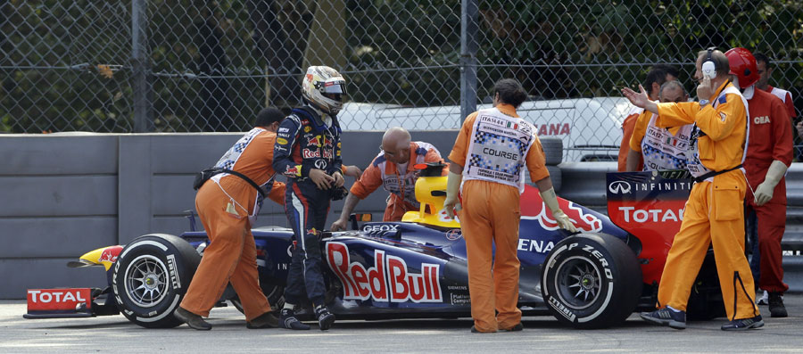 Sebastian Vettel walks away from his stricken Red Bull