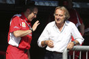 Stefano Domenicali and Luca di Montezemolo enjoy a relaxed chat on the Ferrari pit wall