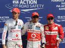 The top three pose for photos in parc ferme