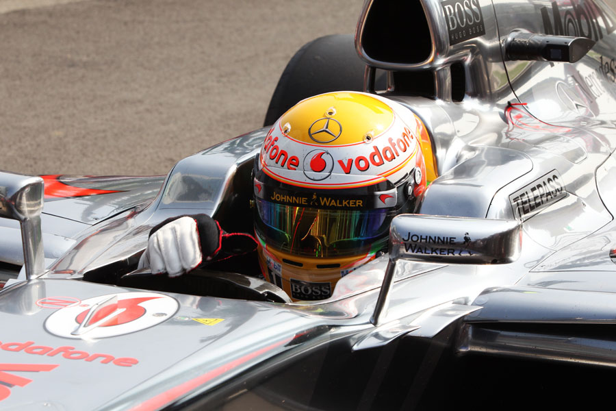 Lewis Hamilton returns to parc ferme after securing pole