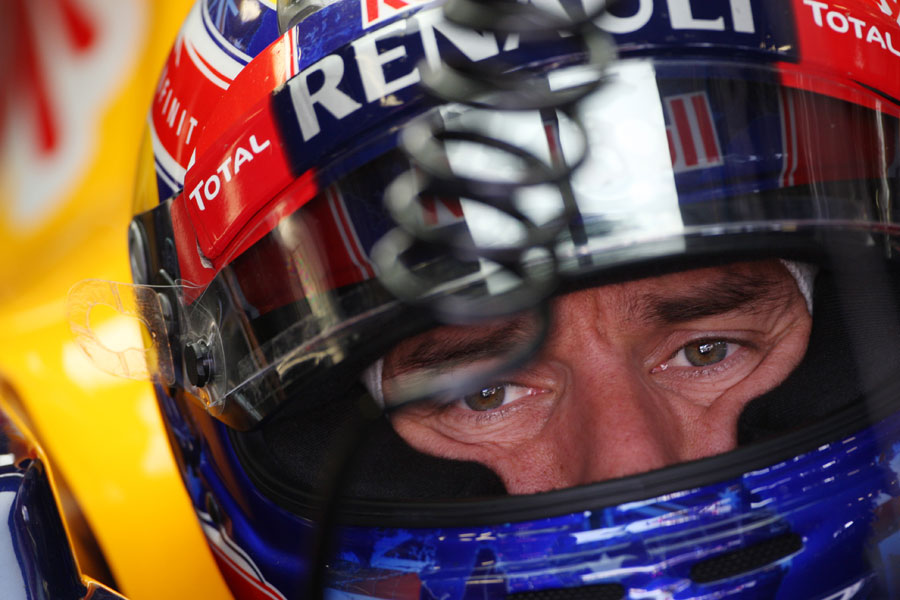 Mark Webber looks concerned as he waits in his RB8