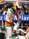 Paul di Resta climbs out of his car after qualifying