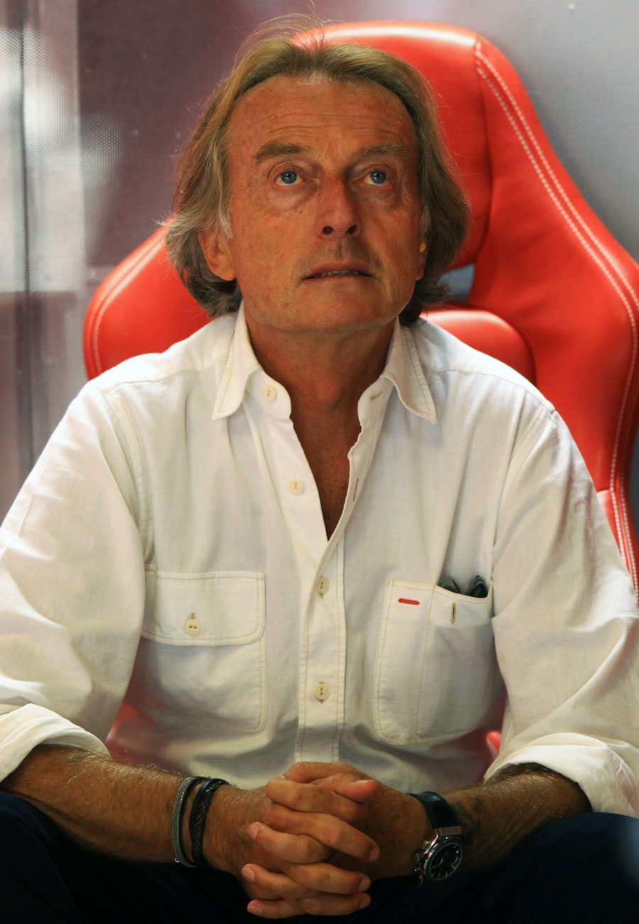 Luca di Montezemolo watches on from the Ferrari garage