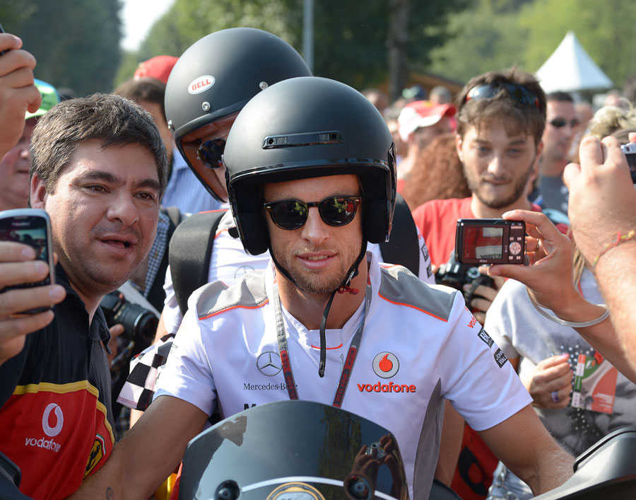 Jenson Button arrives in the paddock on Sunday