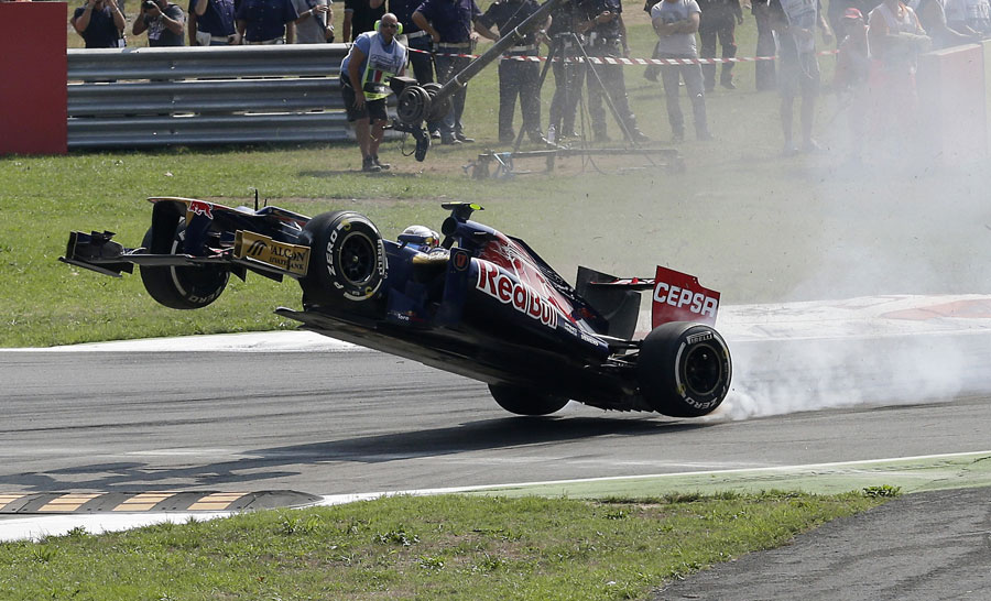 Jean-Eric Vergne launches his car over the kerbs at turn one