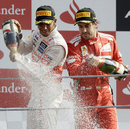 Lewis Hamilton and Fernando Alonso celebrate on the podium