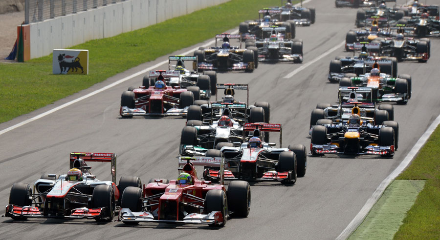 Lewis Hamilton and Felipe Massa side by side off the line