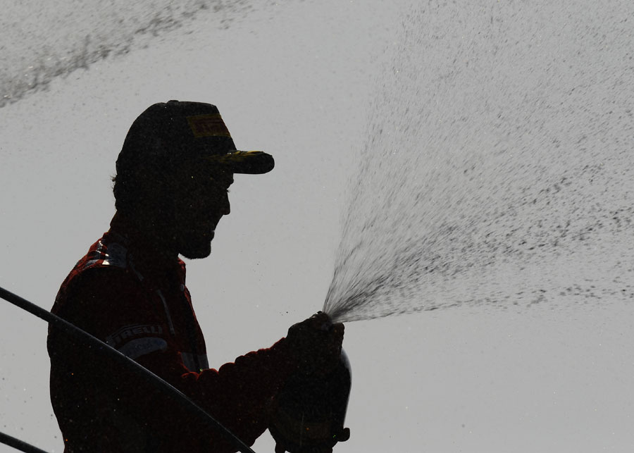 Fernando Alonso sprays the Ferrari faithful