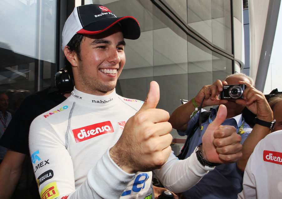 Sergio Perez celebrates second place
