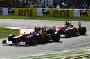 Fernando Alonso leads Felipe Massa on track