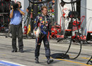 Sebastian Vettel walks back to the Red Bull garage after retiring