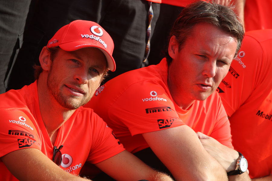 Jenson Button and Sam Michael wait for the McLaren post-race victory photo