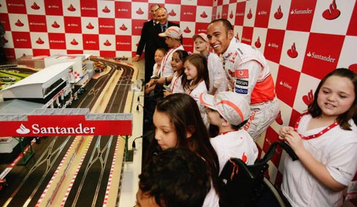 Lewis Hamilton enjoys a Scalextric race with children from Great Ormond Street Hospital