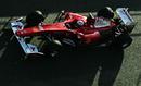 Fernando Alonso drives down the pit lane in his Ferrari