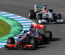 Jenson Button lead Michael Schumacher at Jerez
