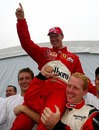 Michael Schumacher celebrates his sixth world title