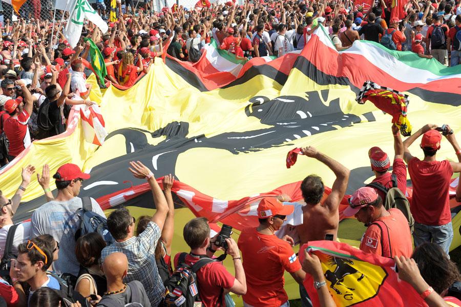 Ferrari supporters celebrate Fernando Alonso's podium finish