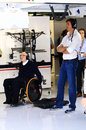 Sir Frank Williams and Toto Wolff watch on from the Williams garage