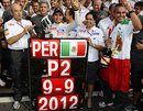Sergio Perez celebrates his second place with Peter Sauber, Monisha Kaltenborn and the rest of the team