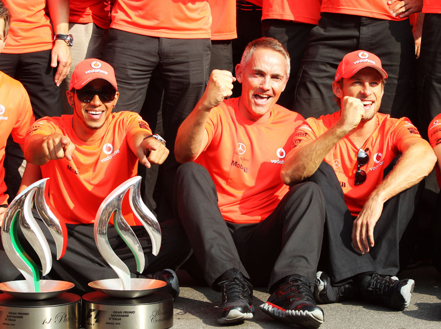 Lewis Hamilton celebrates his victory with Martin Whitmarsh and Jenson Button