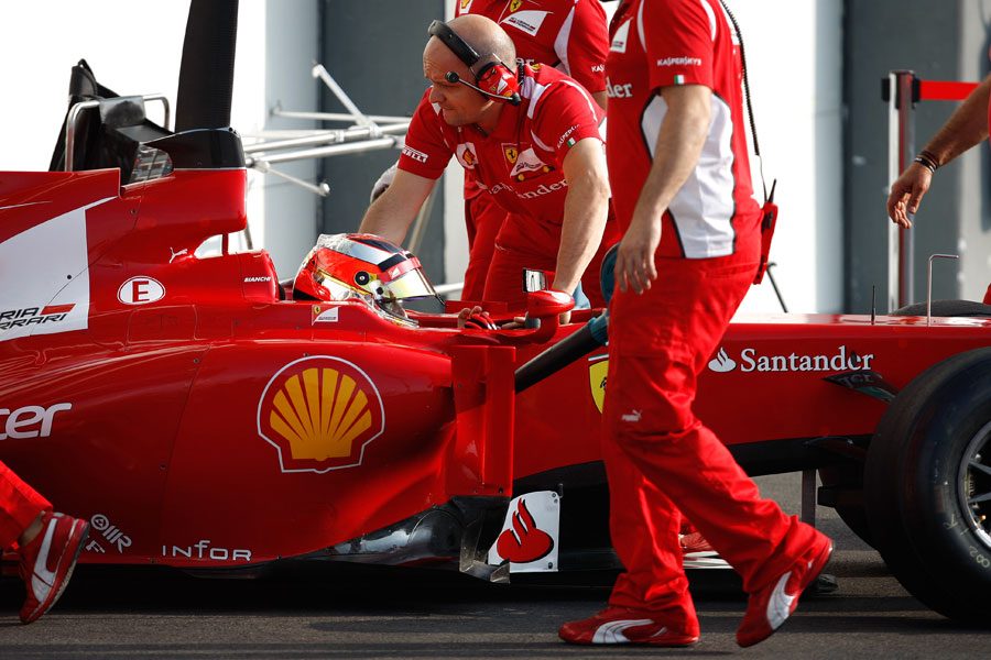 Jules Bianchi is wheeled in to the Ferrari garage