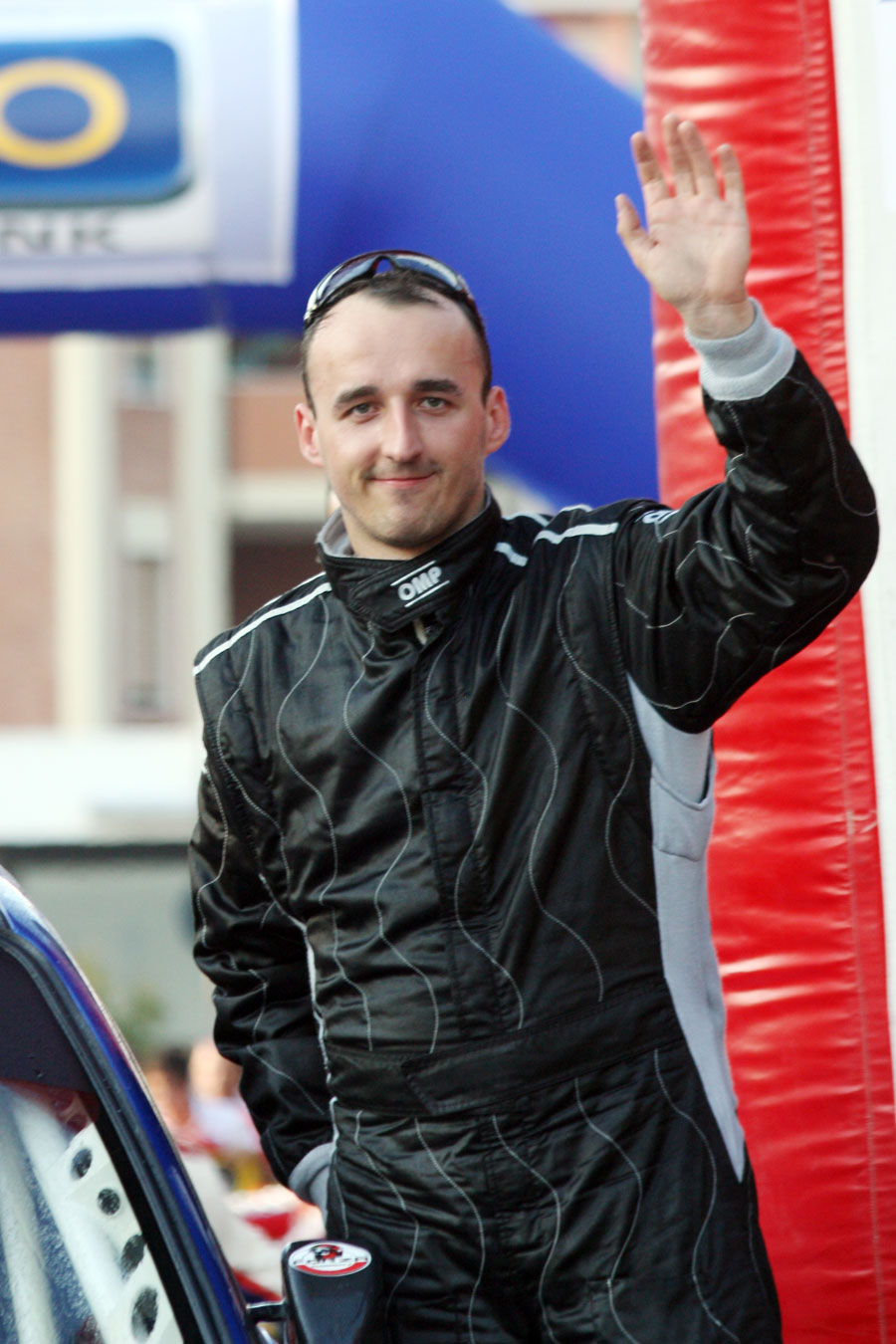 Robert Kubica waves to the crowd on the podium