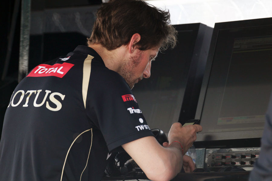 Romain Grosjean on the Lotus pit wall