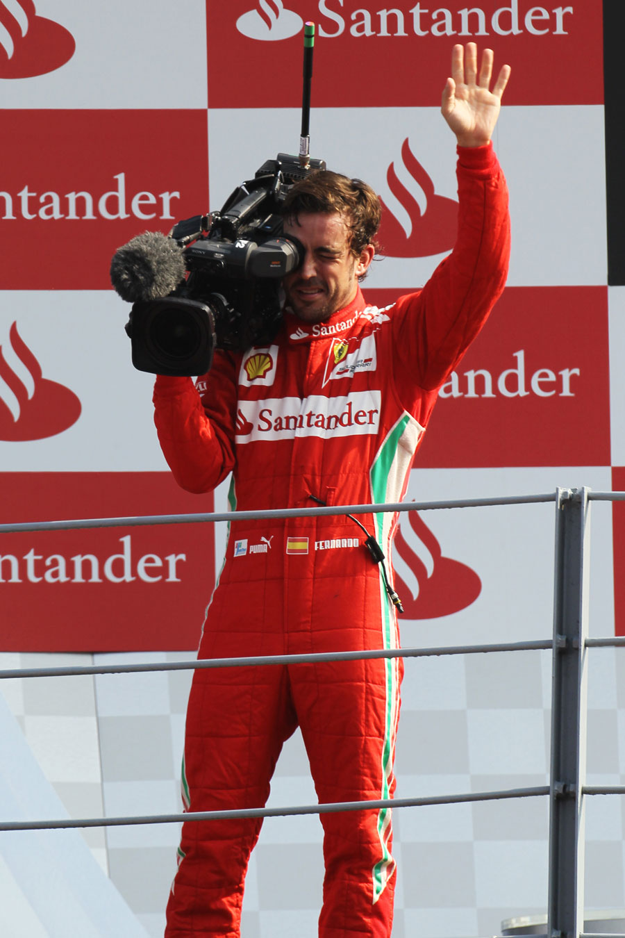 Fernando Alonso plays cameraman on the podium
