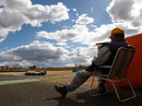 A marshal watches on as Jules Bianchi racks up the laps for Force India