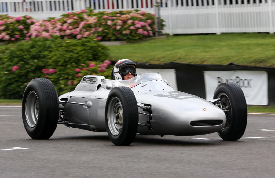 Sir Jackie Stewart displays a Porsche during a Dan Gurney tribute at the Goodwood Revival