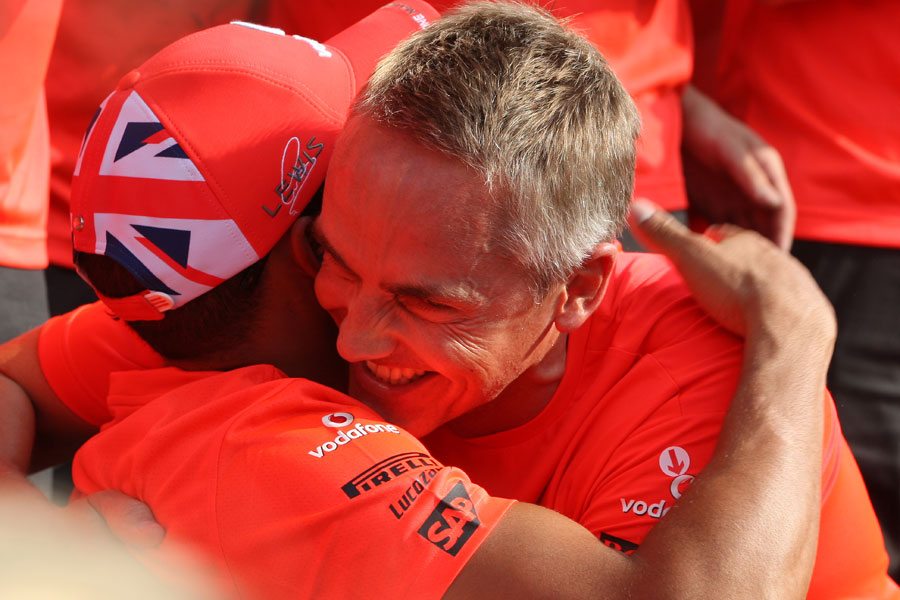 Lewis Hamilton and Martin Whitmarsh ahead of the post-race victory photo