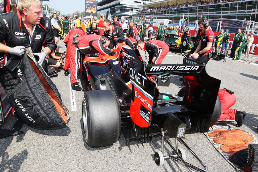Marussia prepares Timo Glock's car on the grid