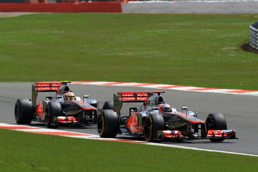 Jenson Button leads Lewis Hamilton on track