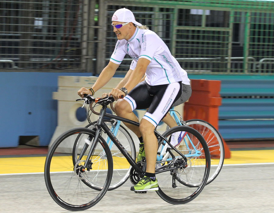 Michael Schumacher cycles the circuit