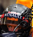 Sebastian Vettel sits in the Red Bull's cockpit with a new LED-lit helmet design