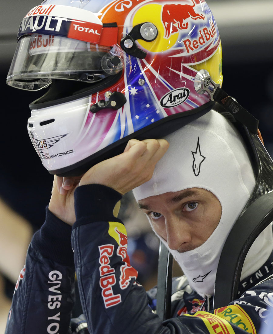 Mark Webber sporting a new helmet design in the Red Bull garage