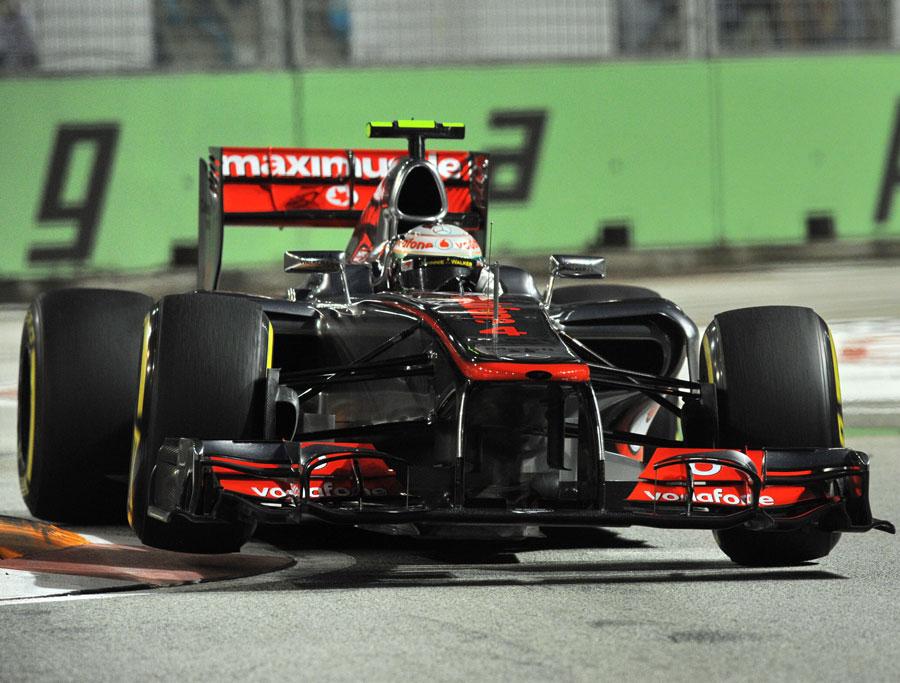 Lewis Hamilton attacks the kerbs