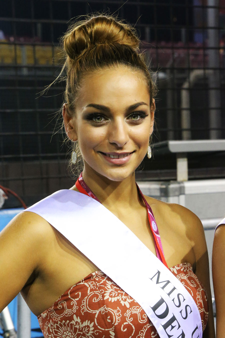 A Miss Universe candidate in the pit lane
