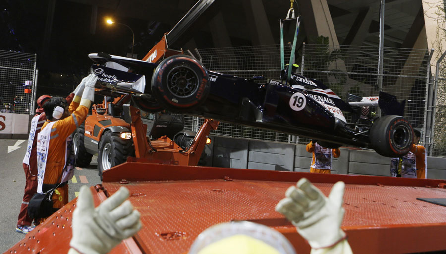 Bruno Senna's Williams gets lifted off the circuit by marshals