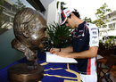 Bruno Senna signs a book of condolence for the late Sid Watkins