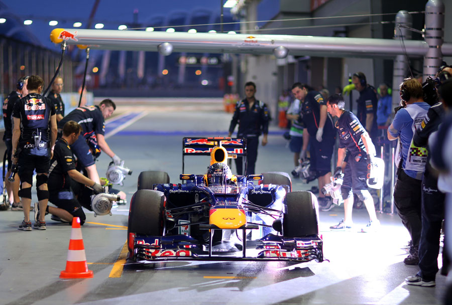 Sebastian Vettel pits after a lap on supersoft tyres