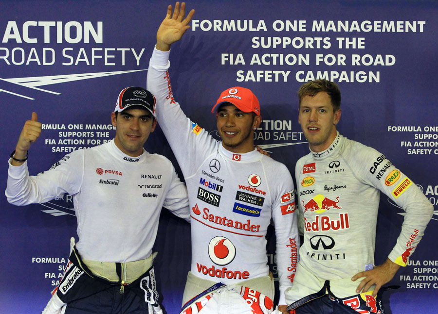 The top three drivers celebrate after qualifying